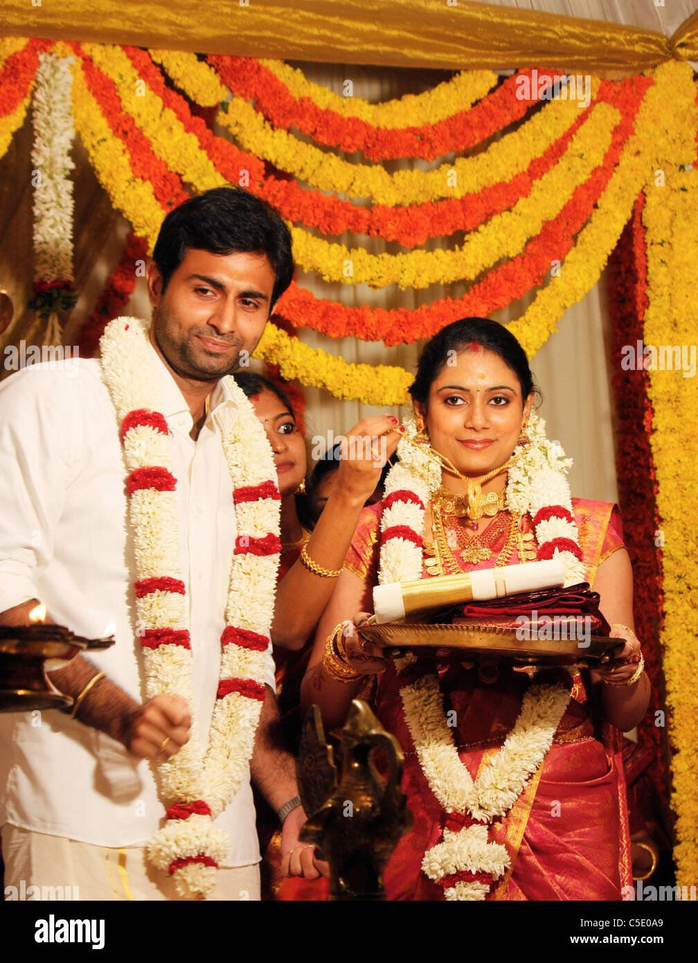 Bride and bridegroom standing after the marriage ceremony in an ...