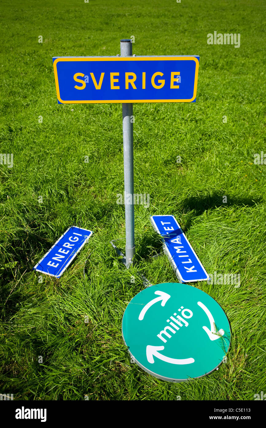Close-up of signboards on the grass - Stock Image