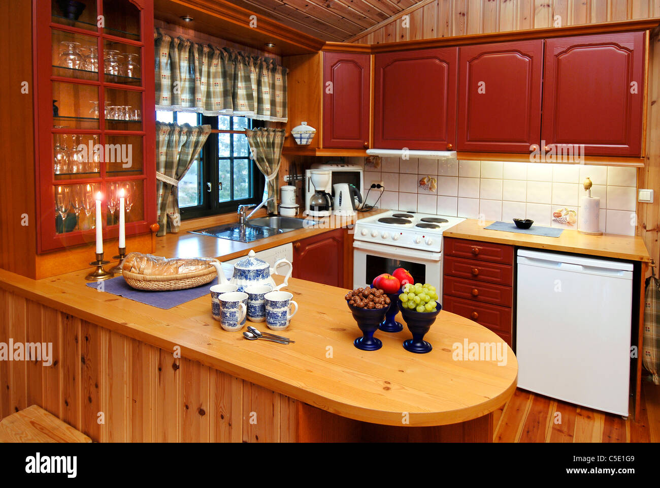 View of wooden countertop with brown cabinets in the kitchen at home Stock Photo