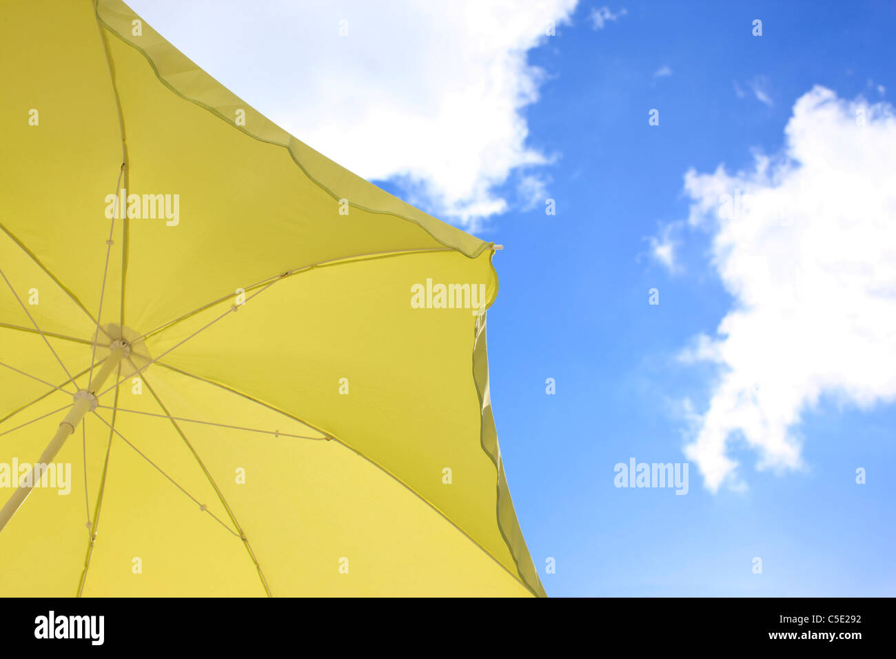 Close-up of cropped canopy against blue sky and clouds Stock Photo