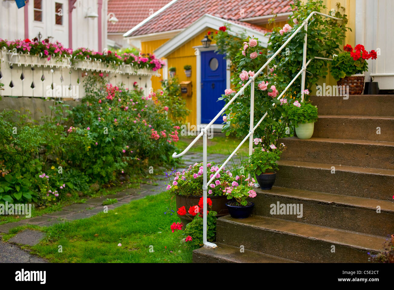 Stairways to the beautiful garden with house in the background - Stock Image