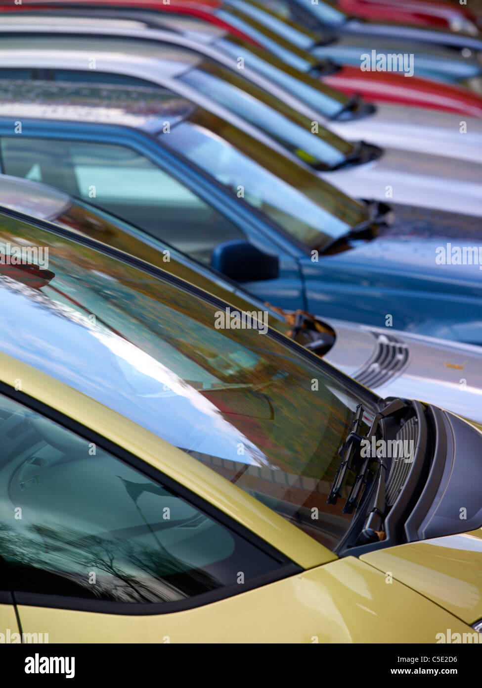 Detail shot of parked cars in a row - Stock Image