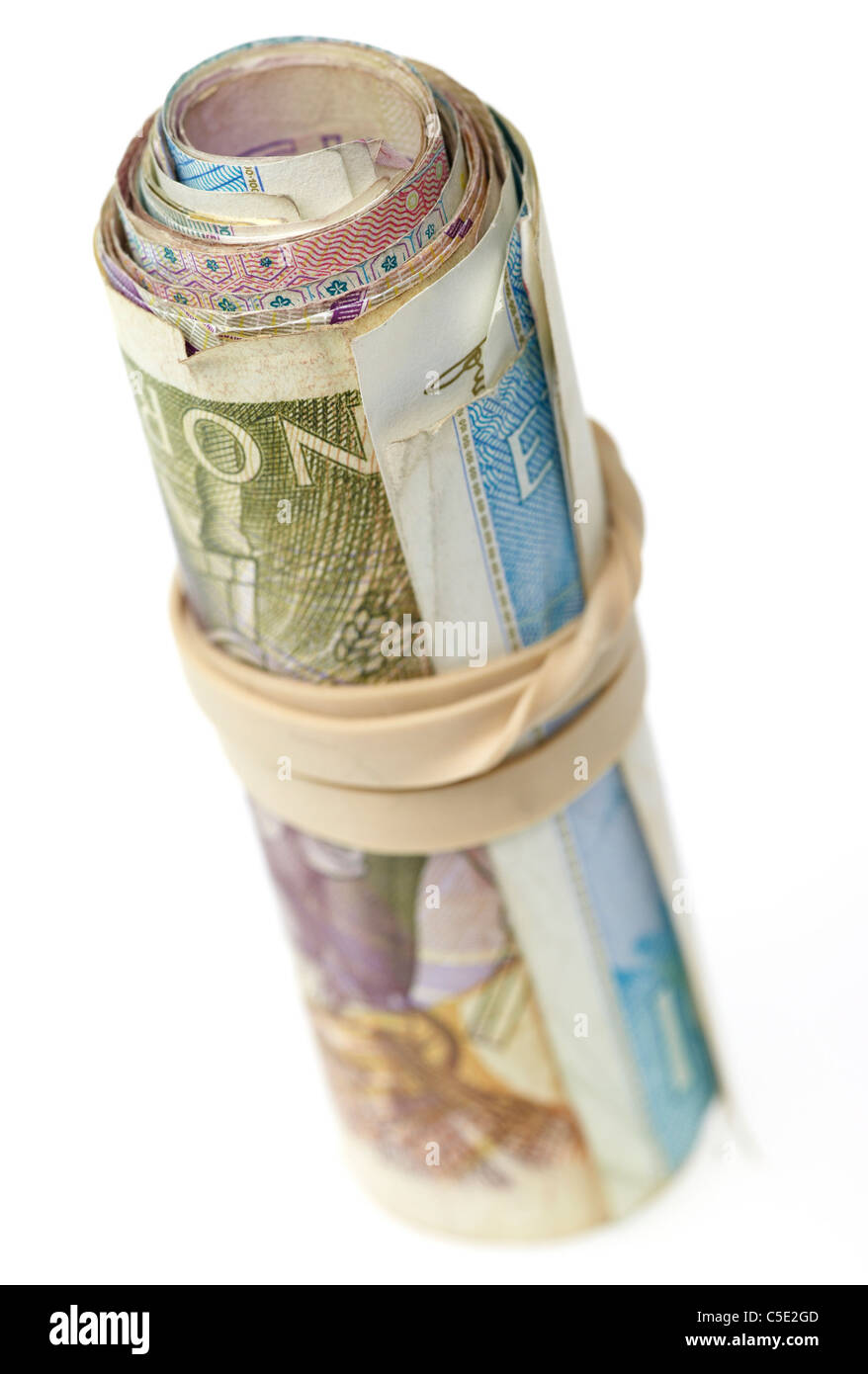 Close-up of rolled banknotes against white background - Stock Image