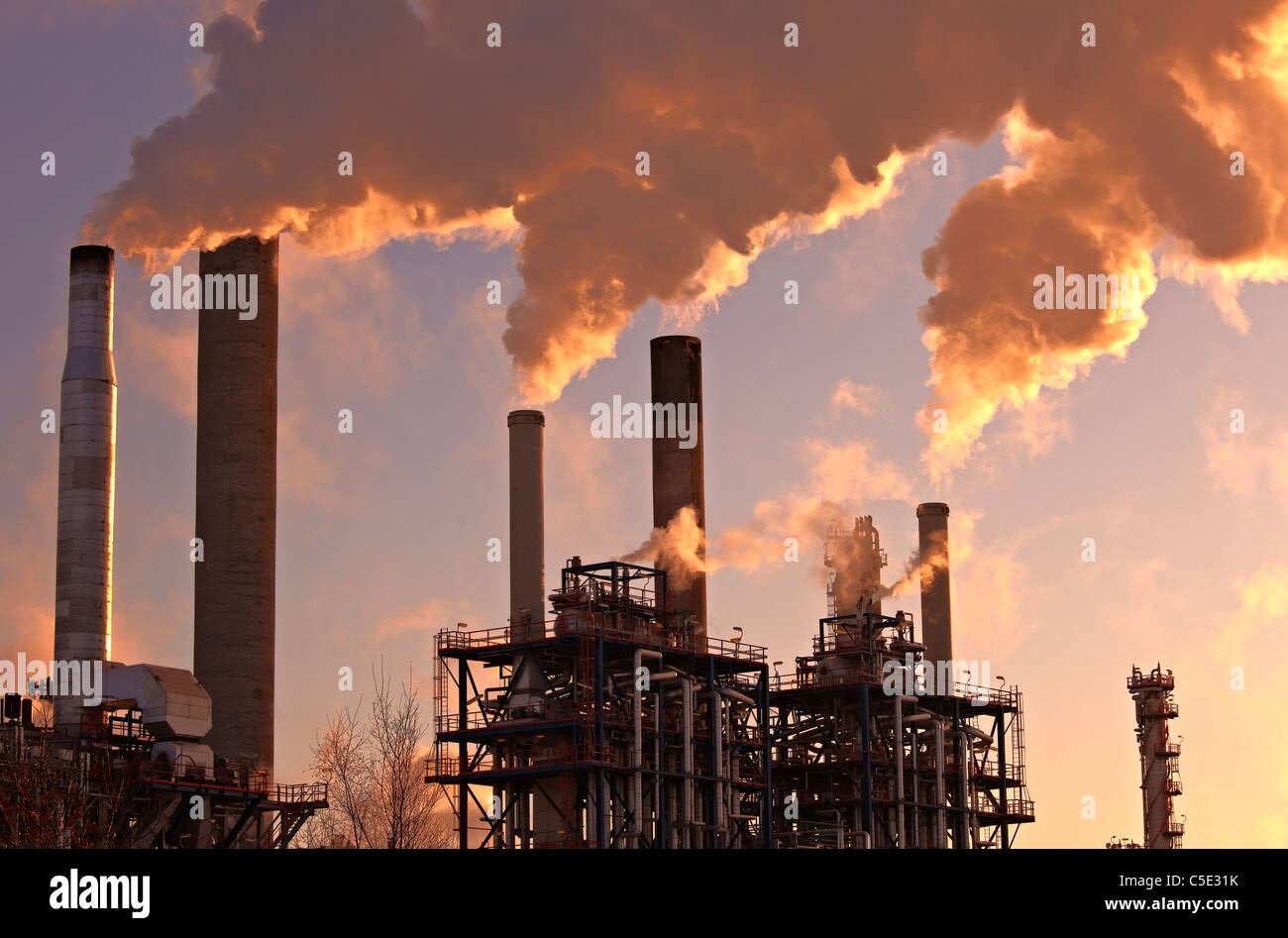 Smokes emitting from chimneys at the industry area Stock Photo