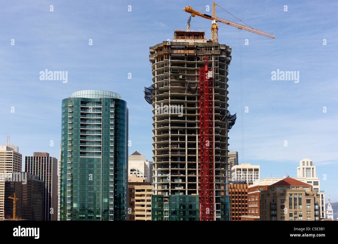 View of new construction of high-rise against blue sky at California, USA - Stock Image