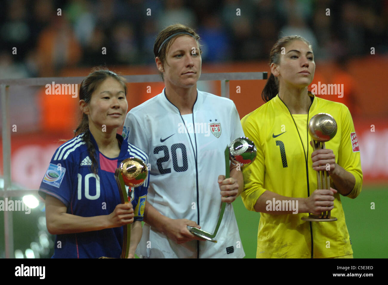 (L-R) Homare Sawa (JPN), Abby Wambach, Hope Solo (USA) posing after the final match between Japan 2(3 PK 1)2 United - Stock Image