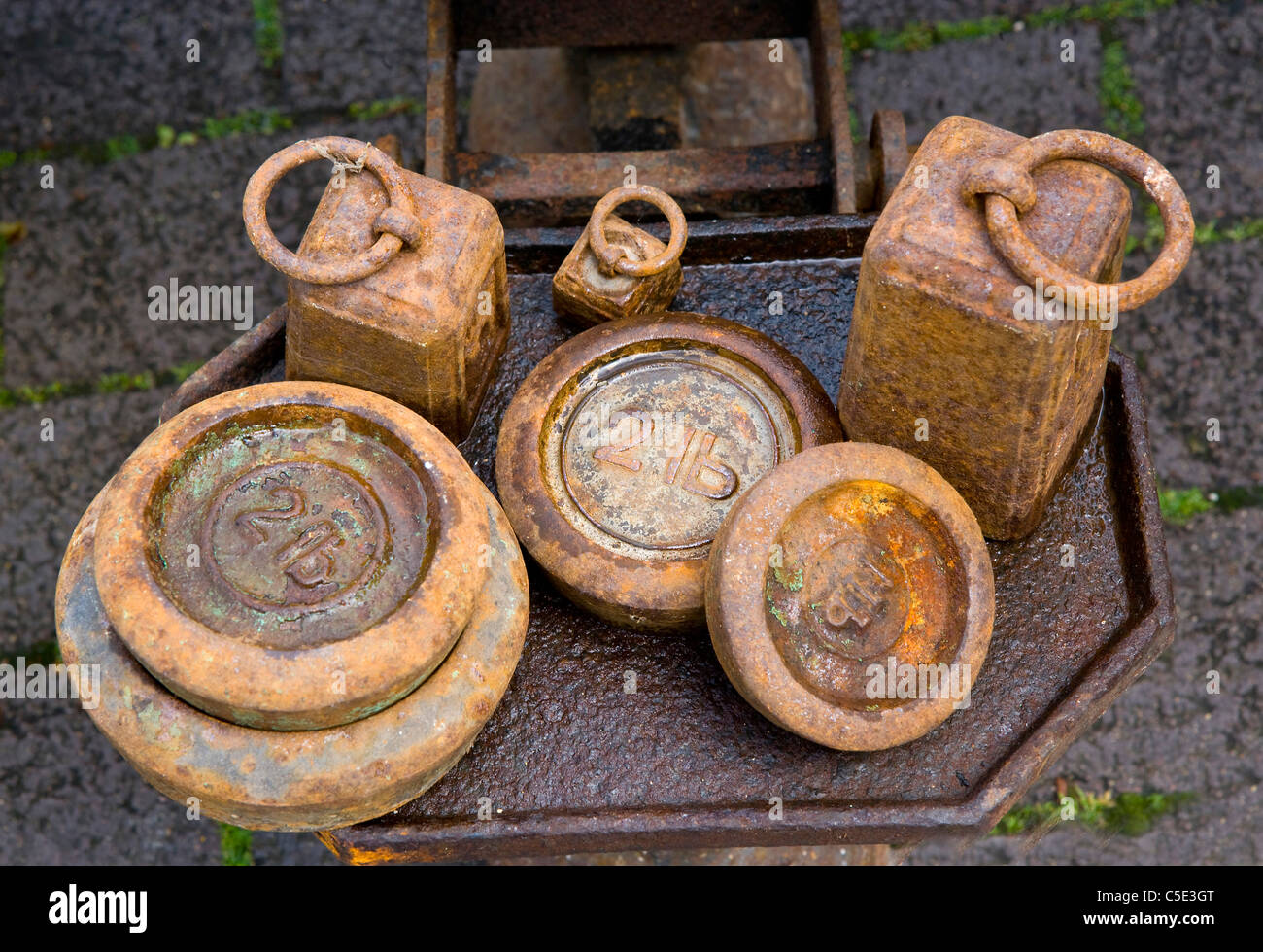 Old weights on scales - Stock Image