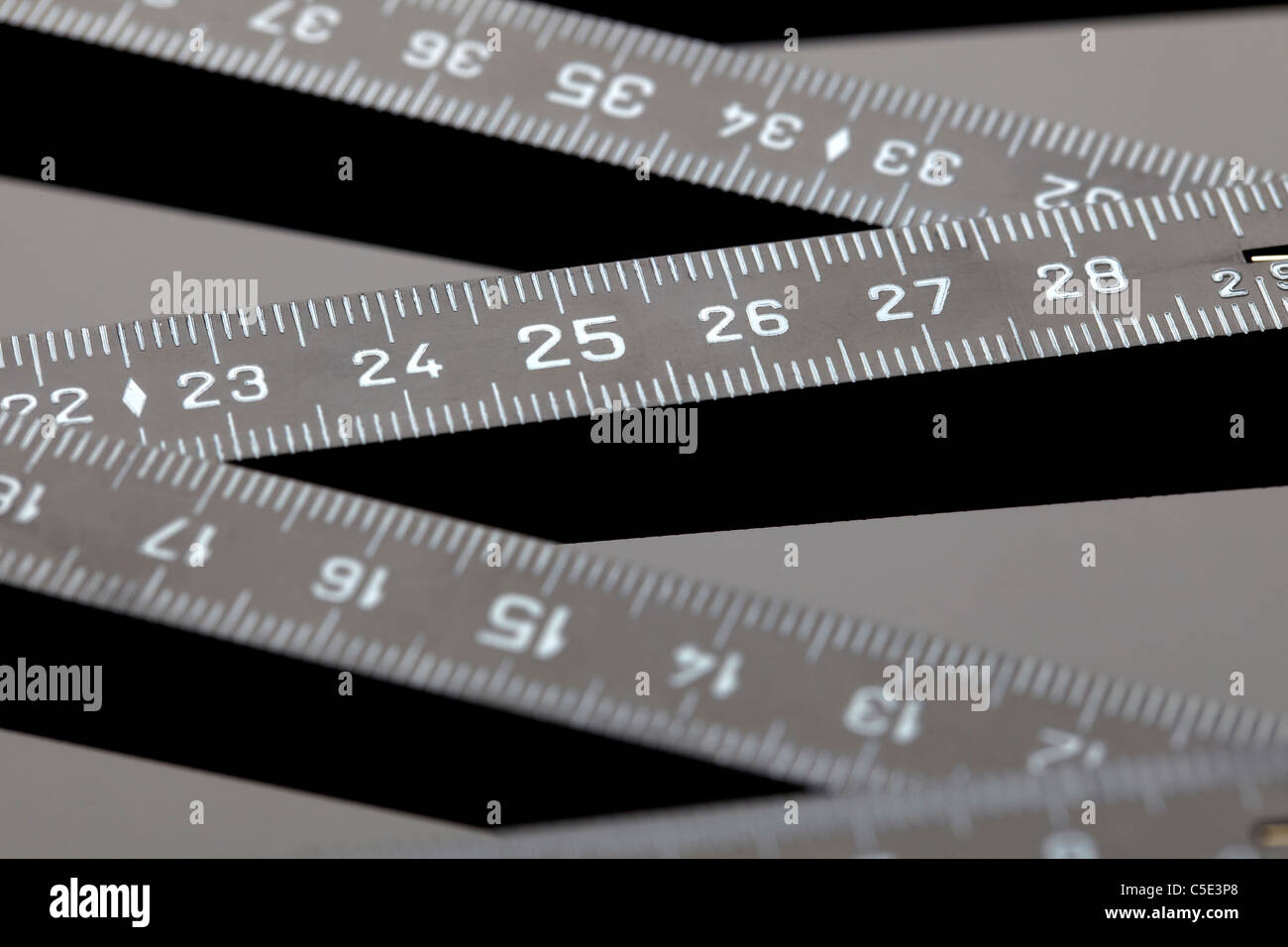 Detail shot of a black folding rule - Stock Image