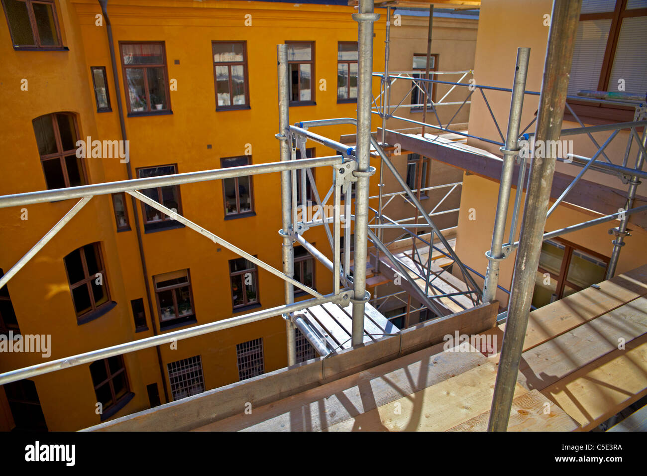 Close-up of scaffolding against building during renovation - Stock Image