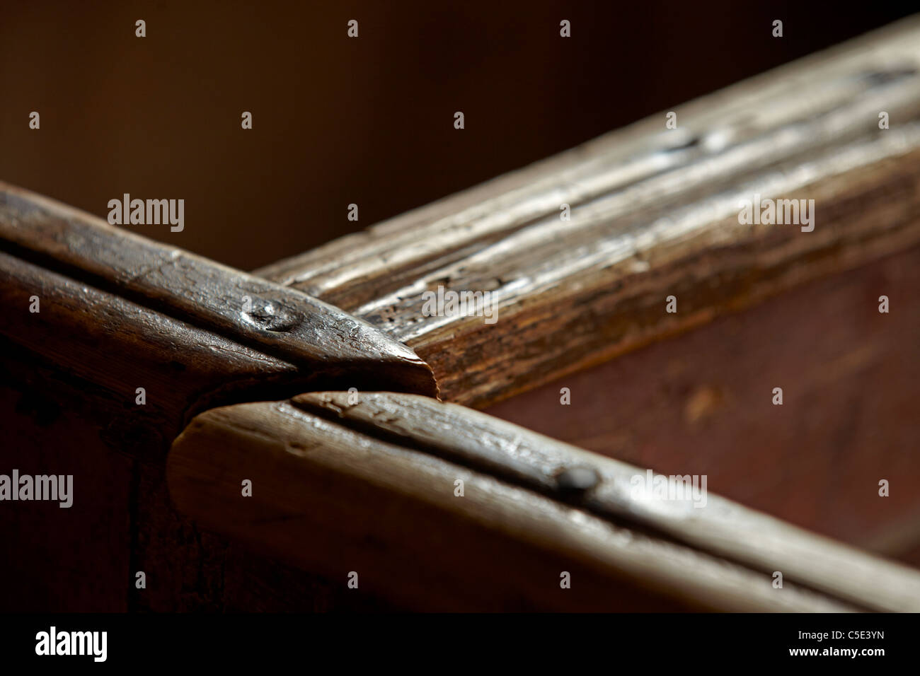 Abstract detail shot of old wooden pews Stock Photo