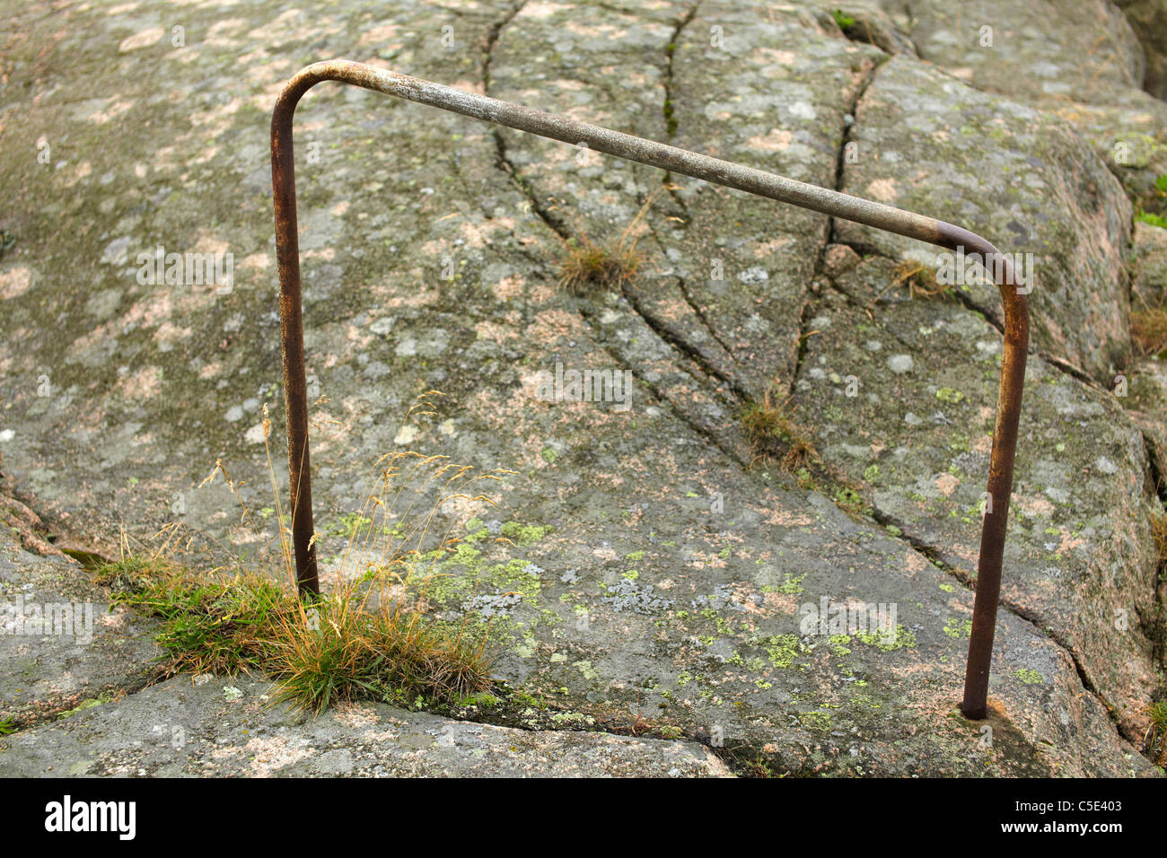 Close-up of a handrail on the rock - Stock Image