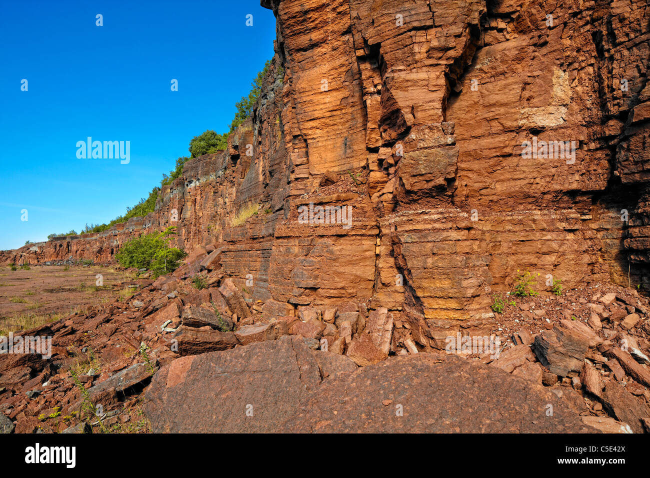 Close-up of shale rocks against clear blue sky - Stock Image