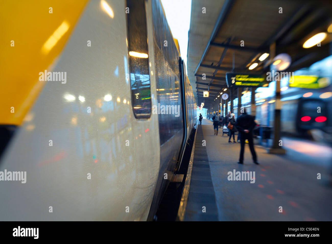 Close-up of a train at the railway station platform - Stock Image