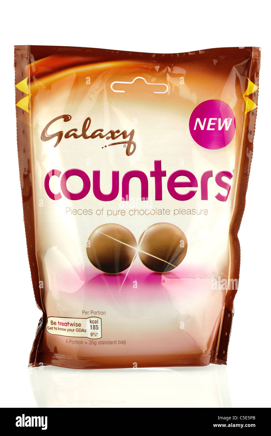 Packet of new Galaxy Counters button chocolates. - Stock Image