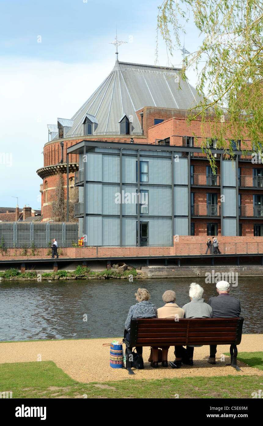 Four Old Age Pensioners or Retired Elderly Sit on Bench Opposite the Royal Shakespeare Theatre at Stratford-upon - Stock Image