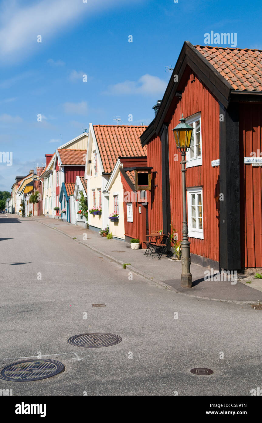 Street with wooden houses in a row against the sky at Kalmar, Sweden - Stock Image