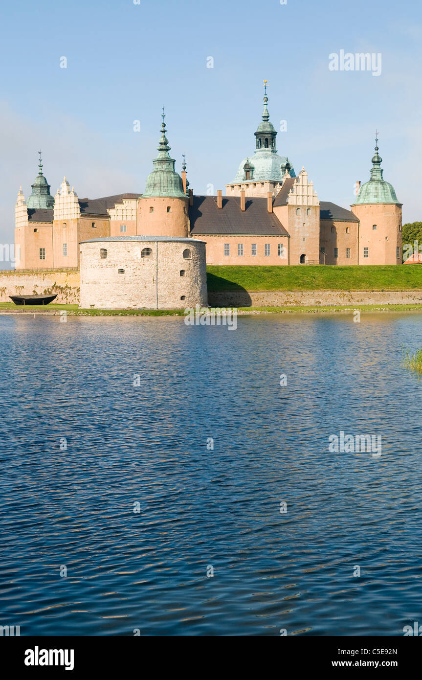 View of the Kalmar castle against clear sky with peaceful lake in the foreground - Stock Image
