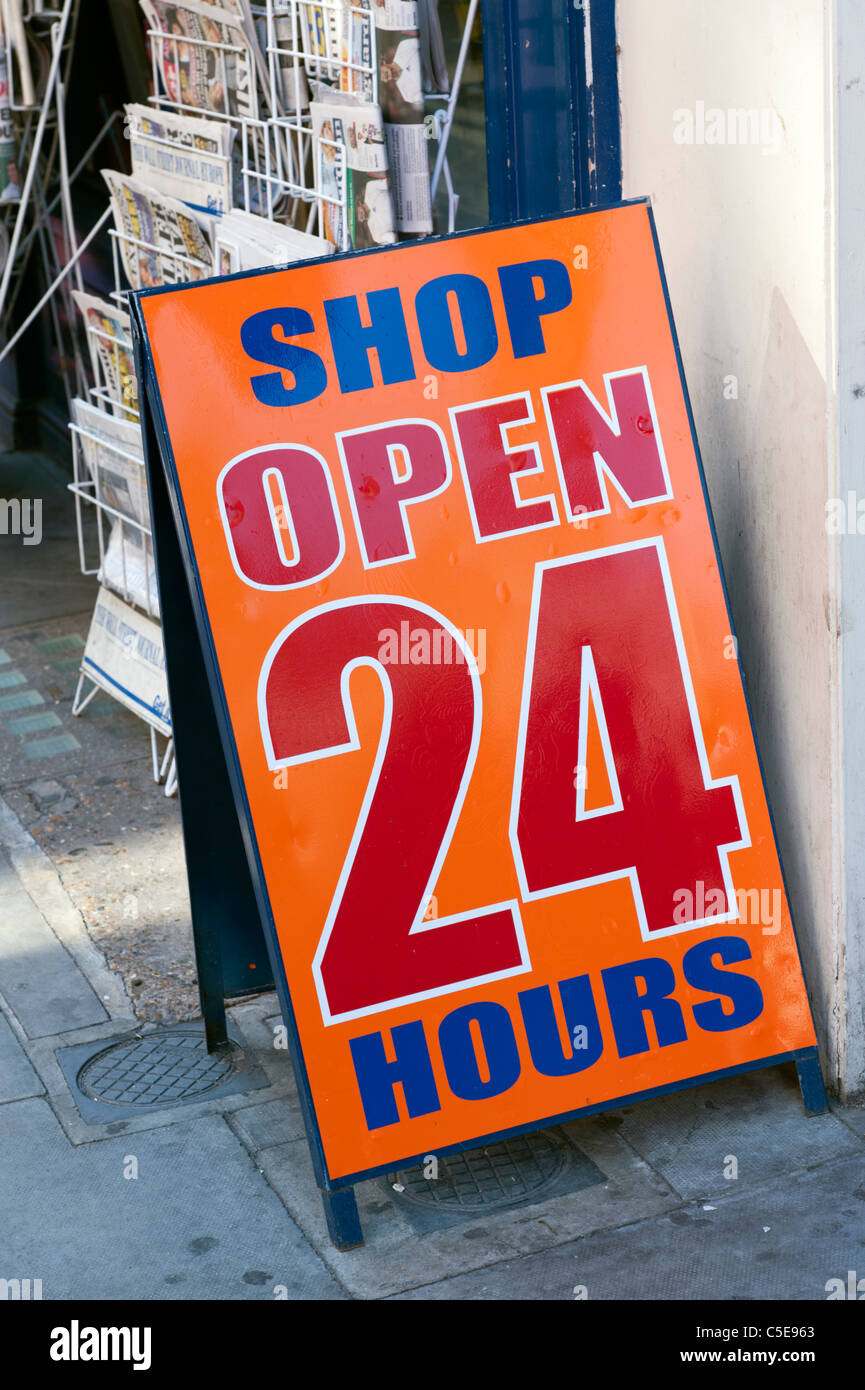 Shop open 24 hours sandwich board on street, UK - Stock Image