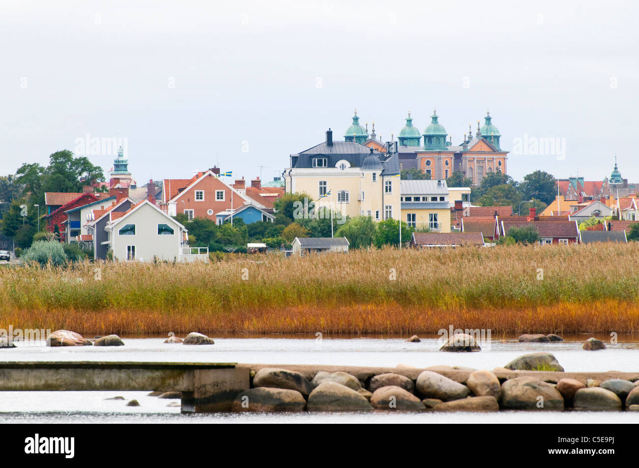 Houses at Kalmar against clear sky with Svinö bridge and fields in the foreground - Stock Image