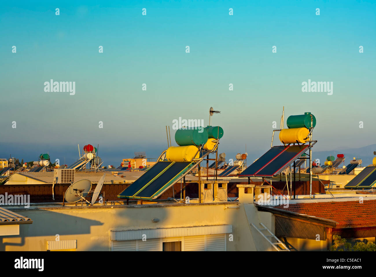 Rooftop hot water solar heating systems Stock Photo: 37809521 - Alamy