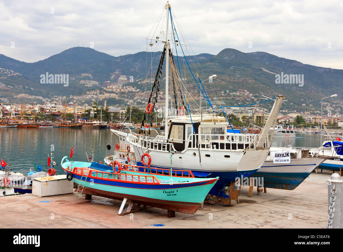 Fishing Boats Ashore for Overhaul in Alanya, Turkey Stock Photo