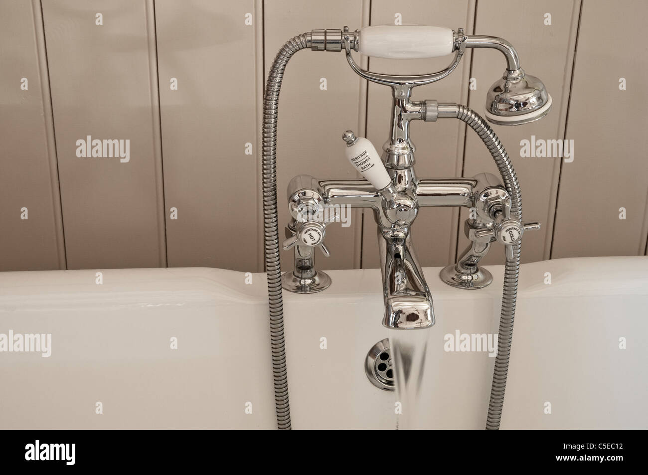 Running a bath - traditional bath taps and showerhead - centred on a ...