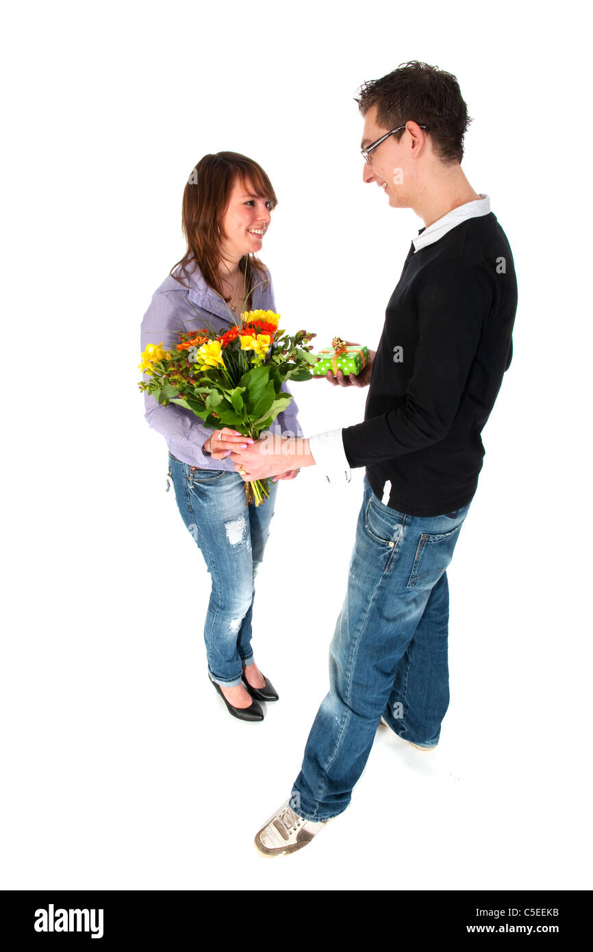 Girl is getting present and flowers from her boyfriend - Stock Image
