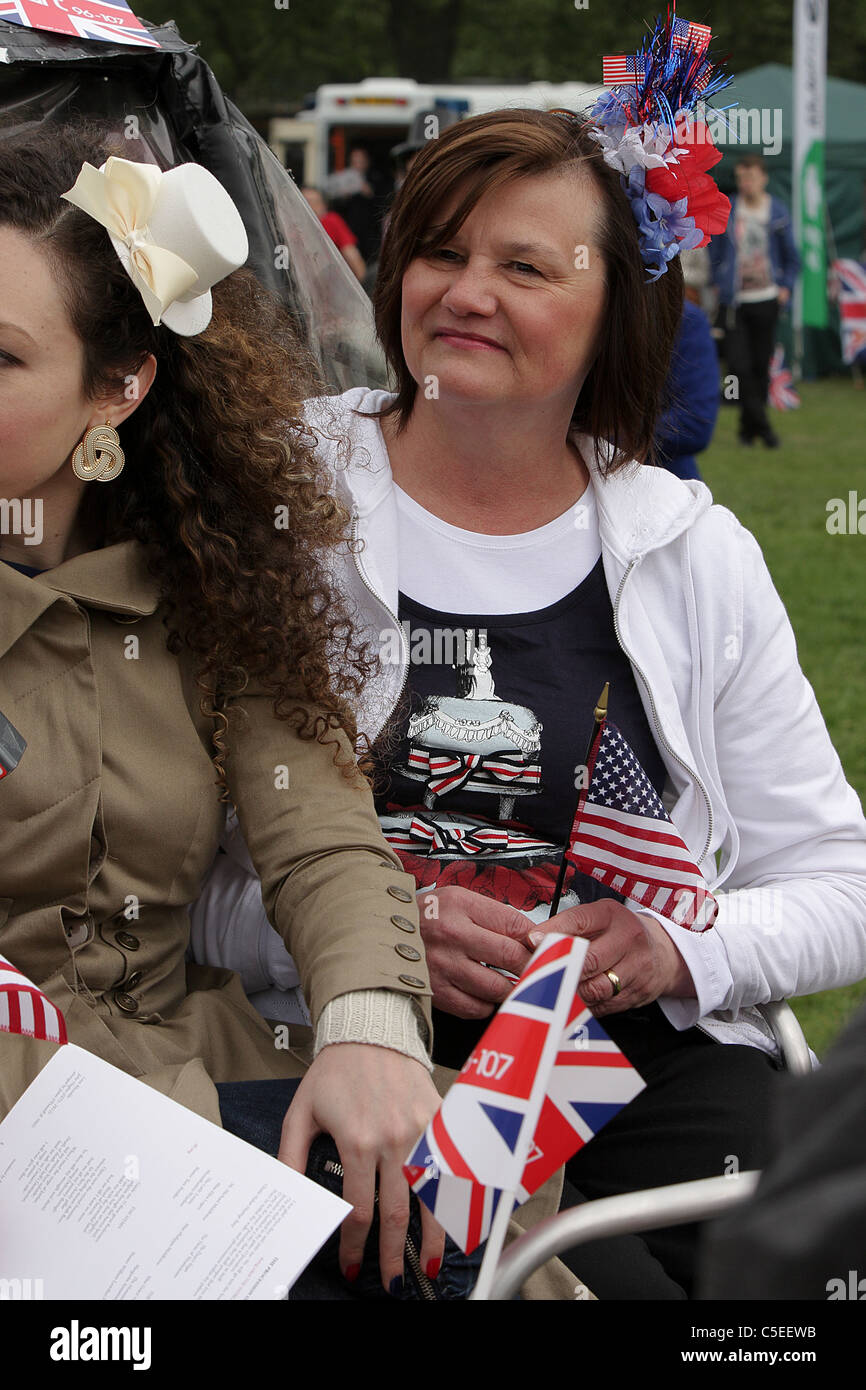 THE ROYAL WEDDING DAY 2011, a patriotic American lady in Green Park soaks up the excitement of the day amongst Royal - Stock Image