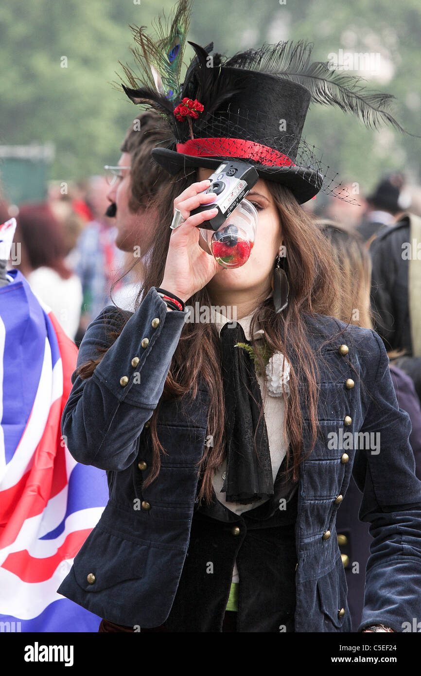 THE ROYAL WEDDING DAY 20011, young female reveller enjoys a quick drink whilst enjoying the happy atmosphere in - Stock Image