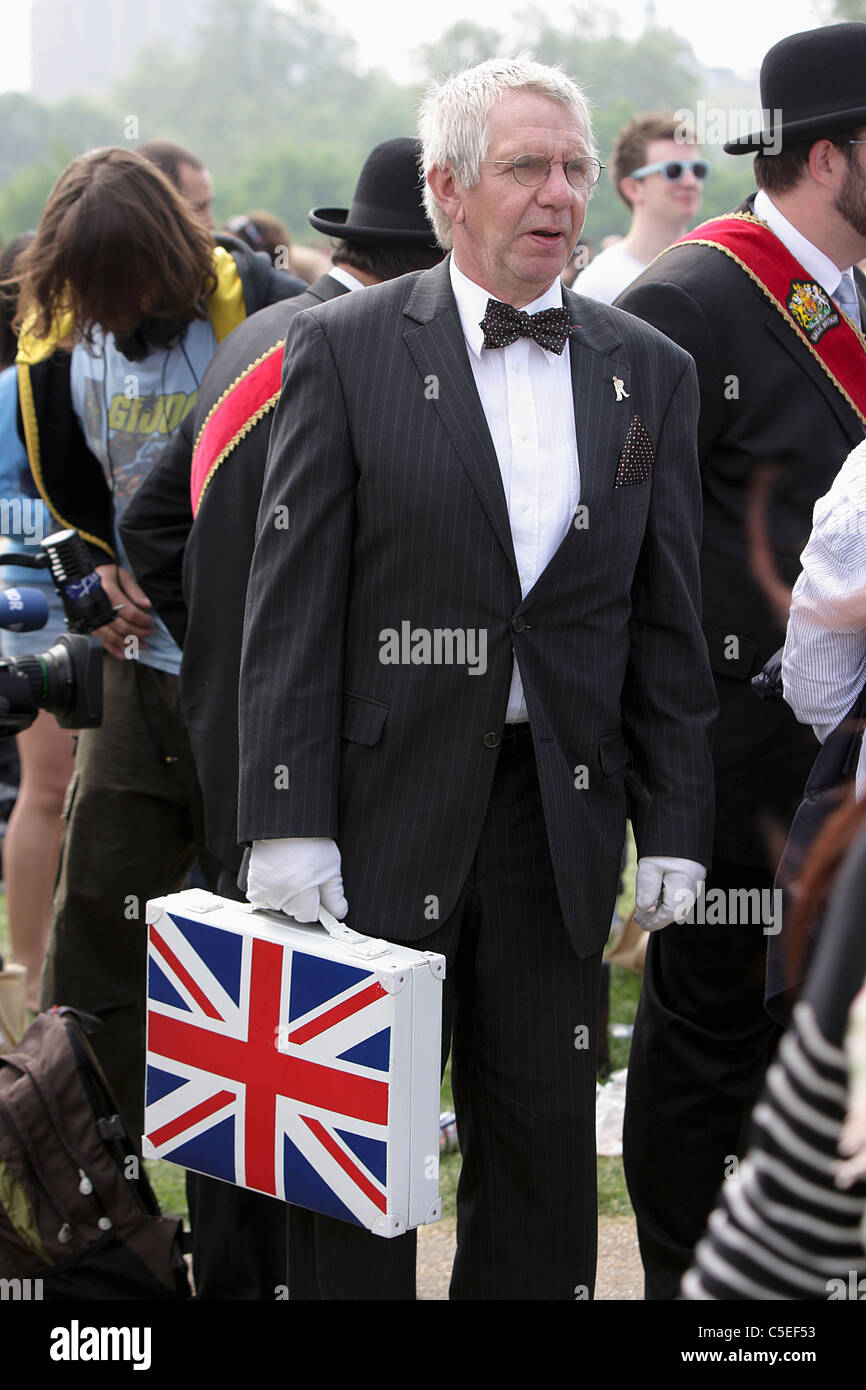 THE ROYAL WEDDING DAY 2011, patriotic reveller dressed in black and white and holding an Union Jack brief case. - Stock Image