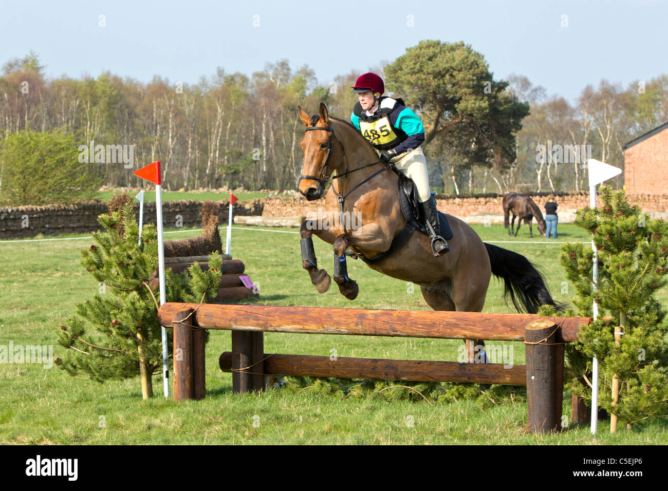 Horse jumping over fence at a British Eventing  competition - Stock Image