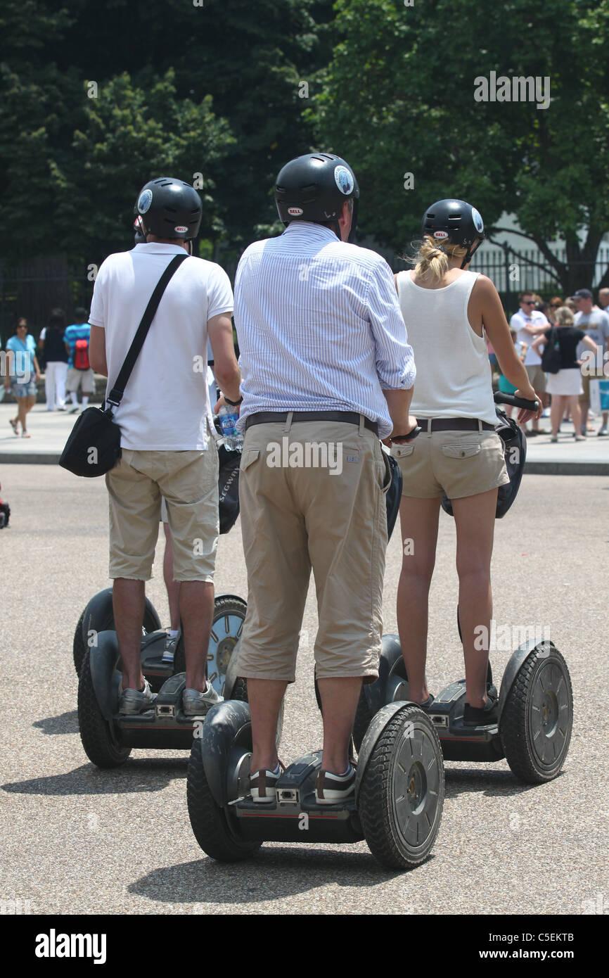 Three tourists on Segways in Washington, DC Stock Photo