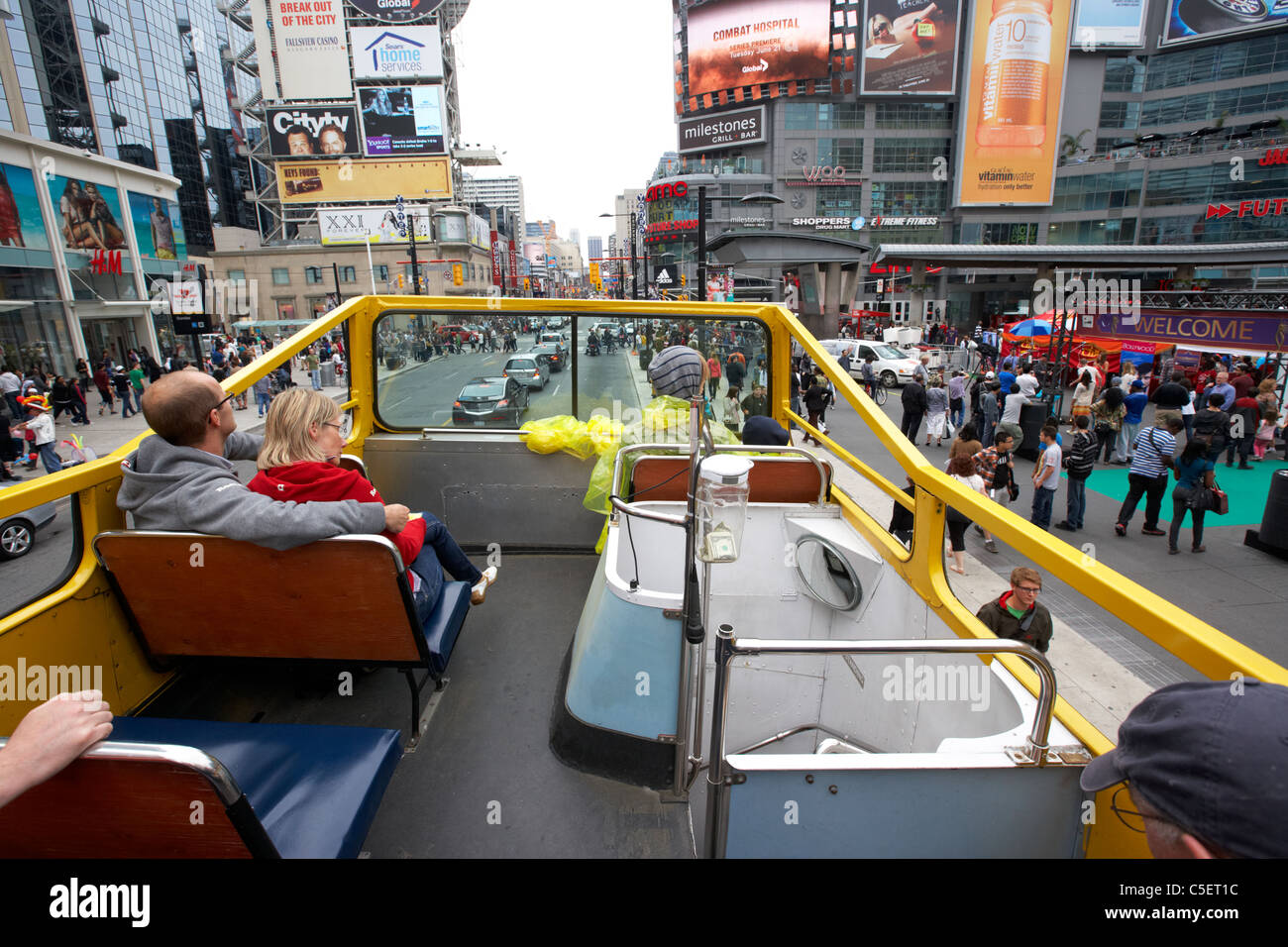 open top guided bus city tour top deck downtown yonge dundas square toronto ontario canada - Stock Image