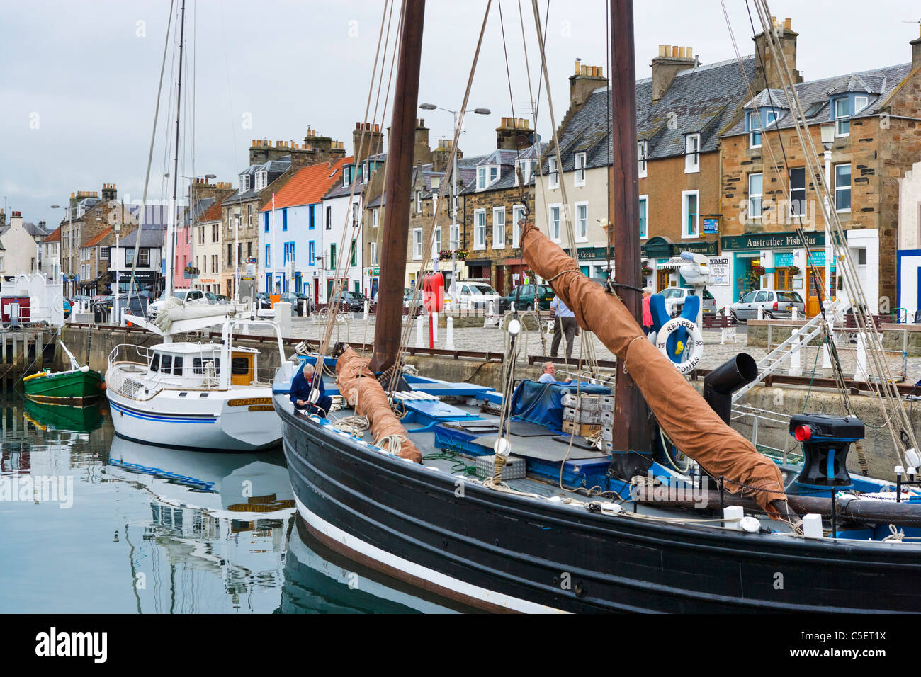 The waterfront and historic Fife herring drifter Reaper in Anstruther harbour, East Neuk, Fife, Scotland, UK - Stock Image