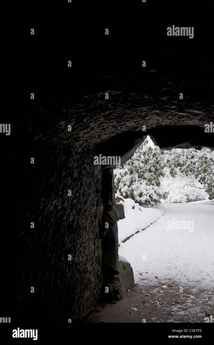 Snow outside a dark tunnel - Stock Image