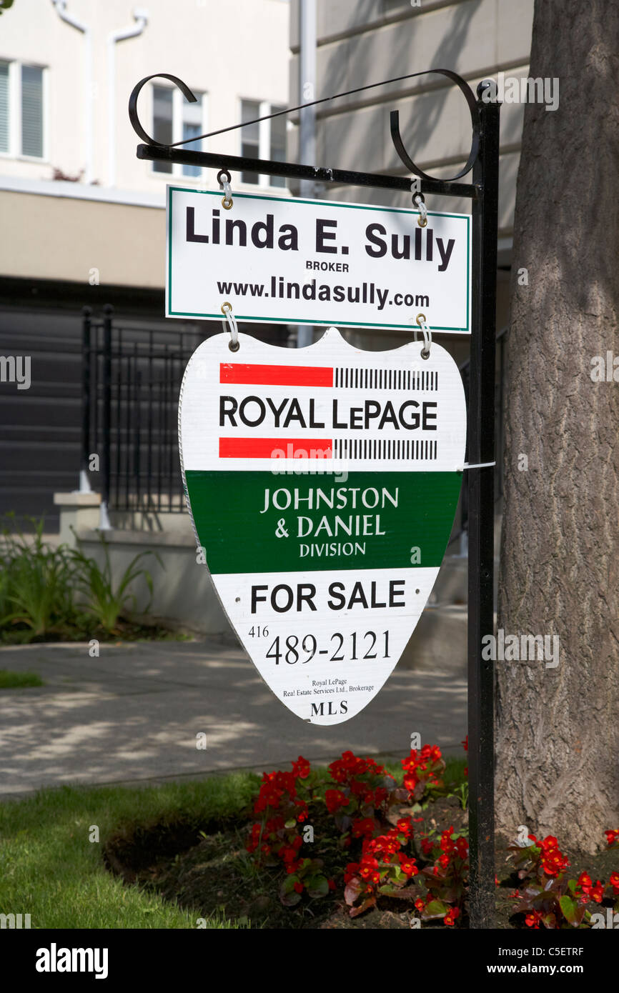 for sale sign in the garden of upmarket house in casa loma spadina area of toronto ontario canada - Stock Image