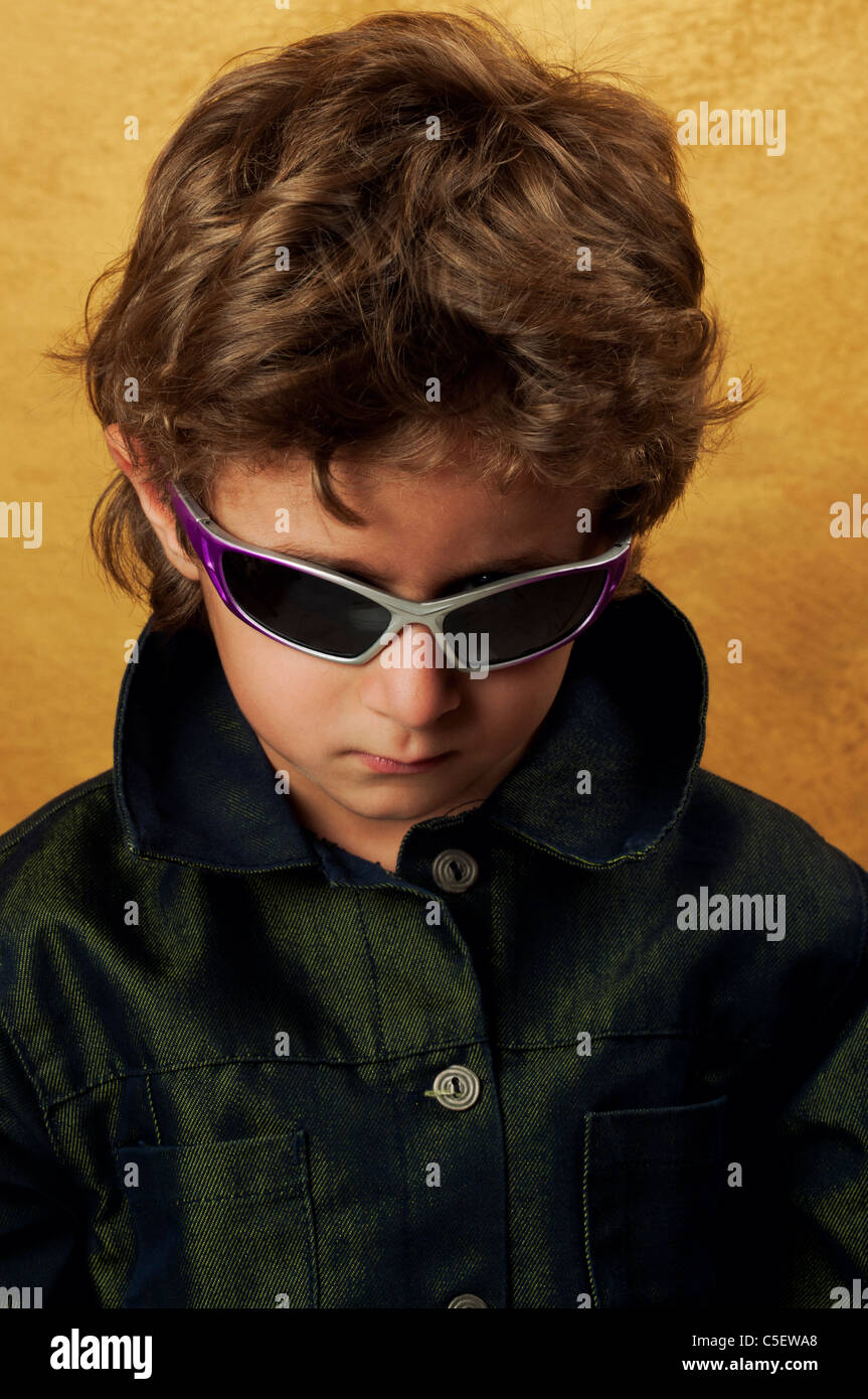 Little kid wearing black jacket and sunglasses Stock Photo