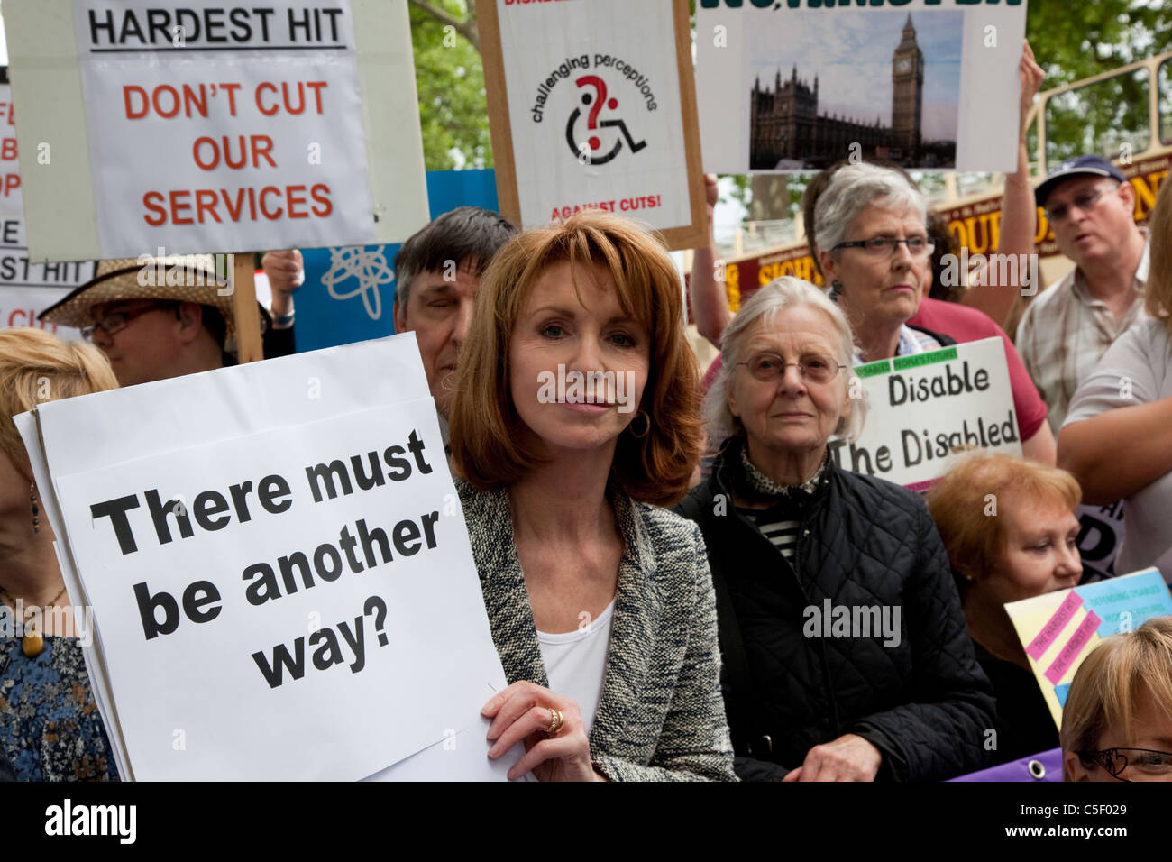 Thousands of disabled people marched through London on the Hardest Hit March to protest against governmental budget - Stock Image