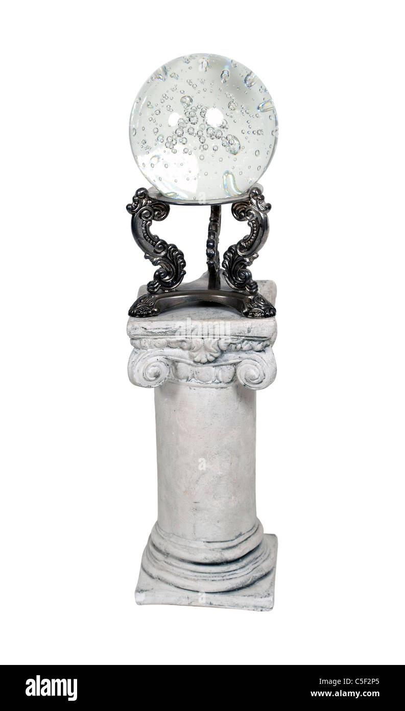 Crystal ball on a stone pedestal - Stock Image