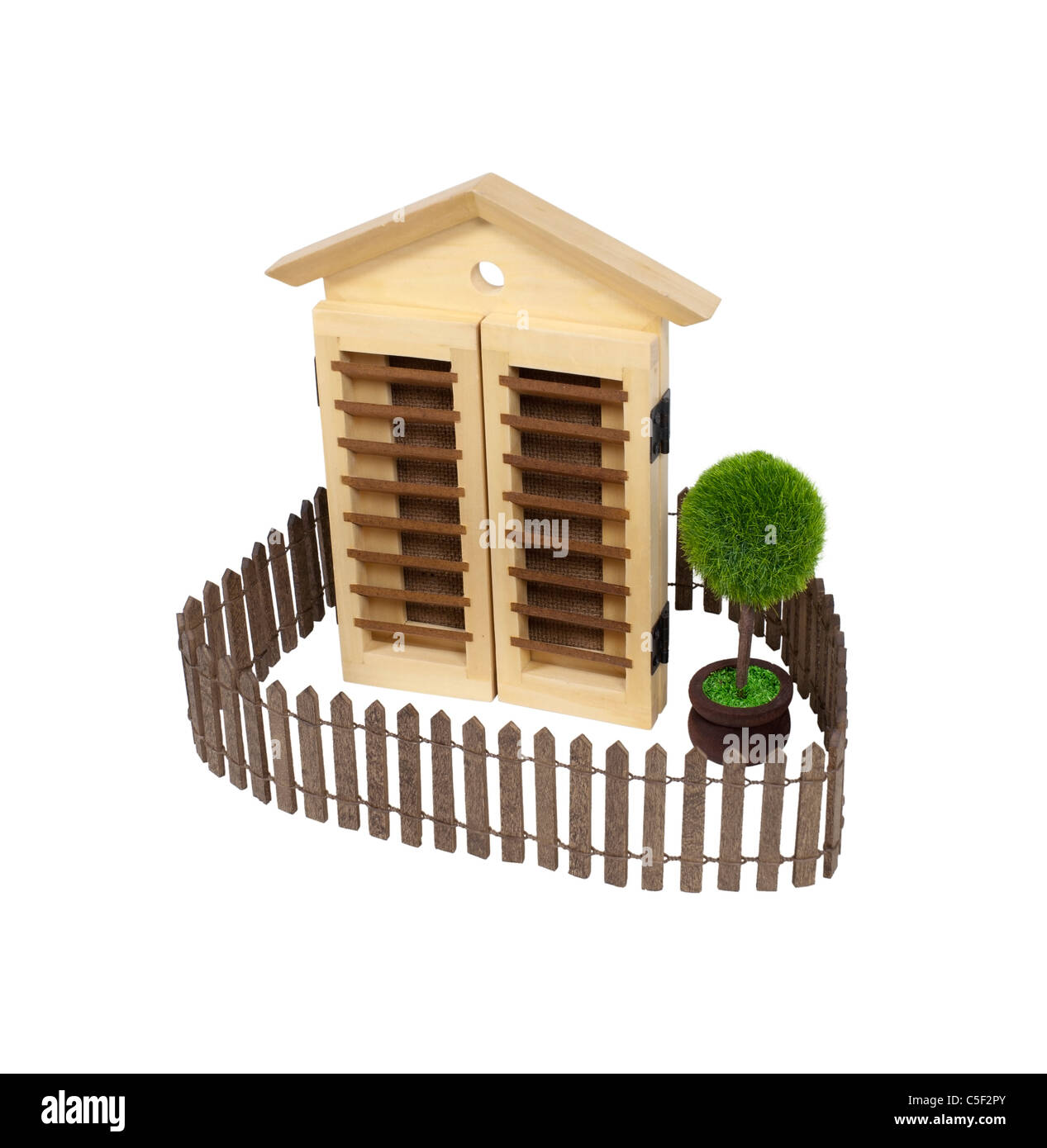 House with picket fence and a tree in the yard - path included - Stock Image
