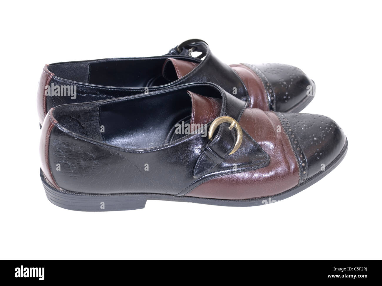 Black and tan leather saddle shoes with metal buckle - path included - Stock Image