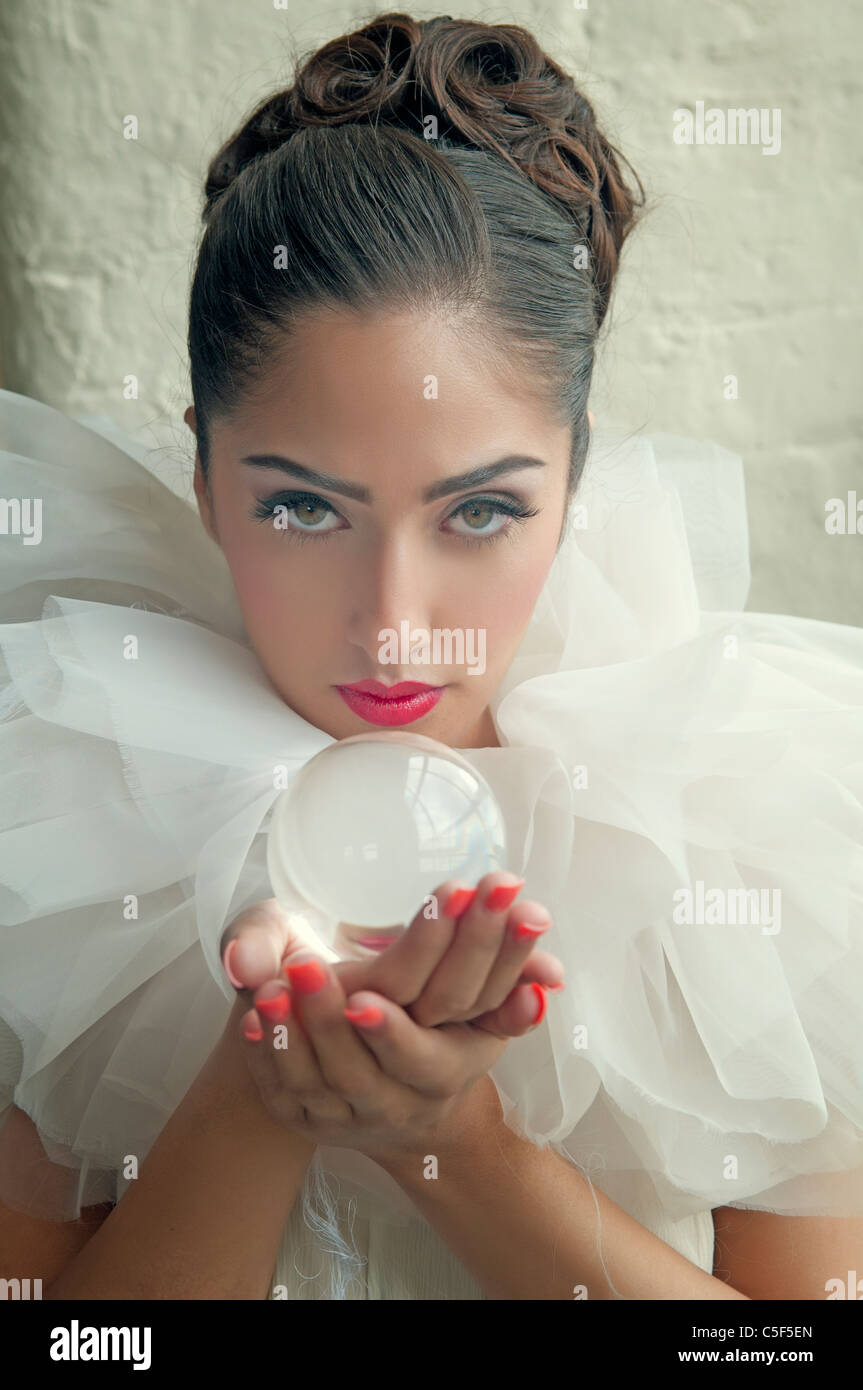 Woman holding a crystal ball - Stock Image