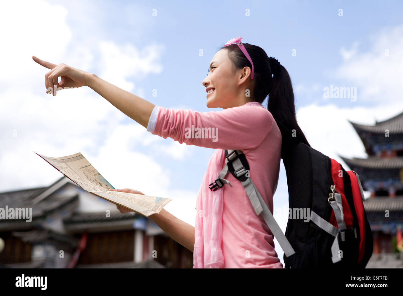 Young Woman Exploring Dali with Map - Stock Image