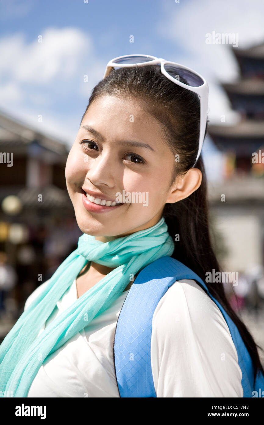 Portrait of a smiling young woman - Stock Image