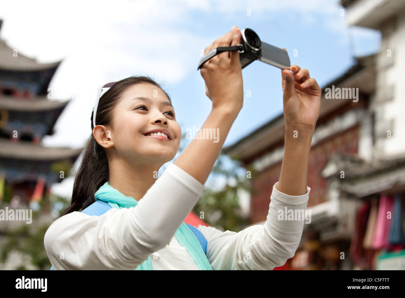 Young Woman Exploring Dali with DV - Stock Image
