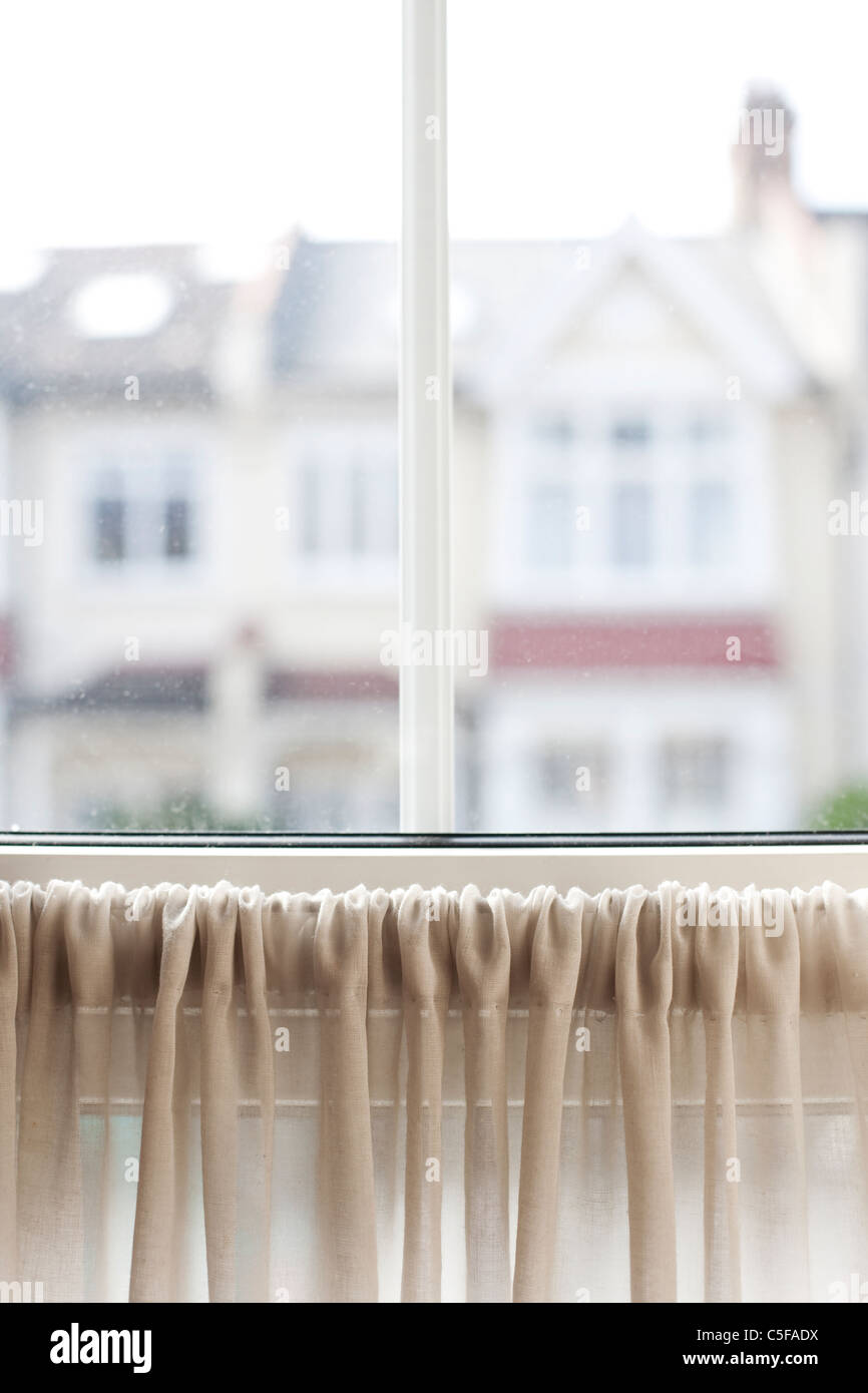 View of suburban houses through window - Stock Image