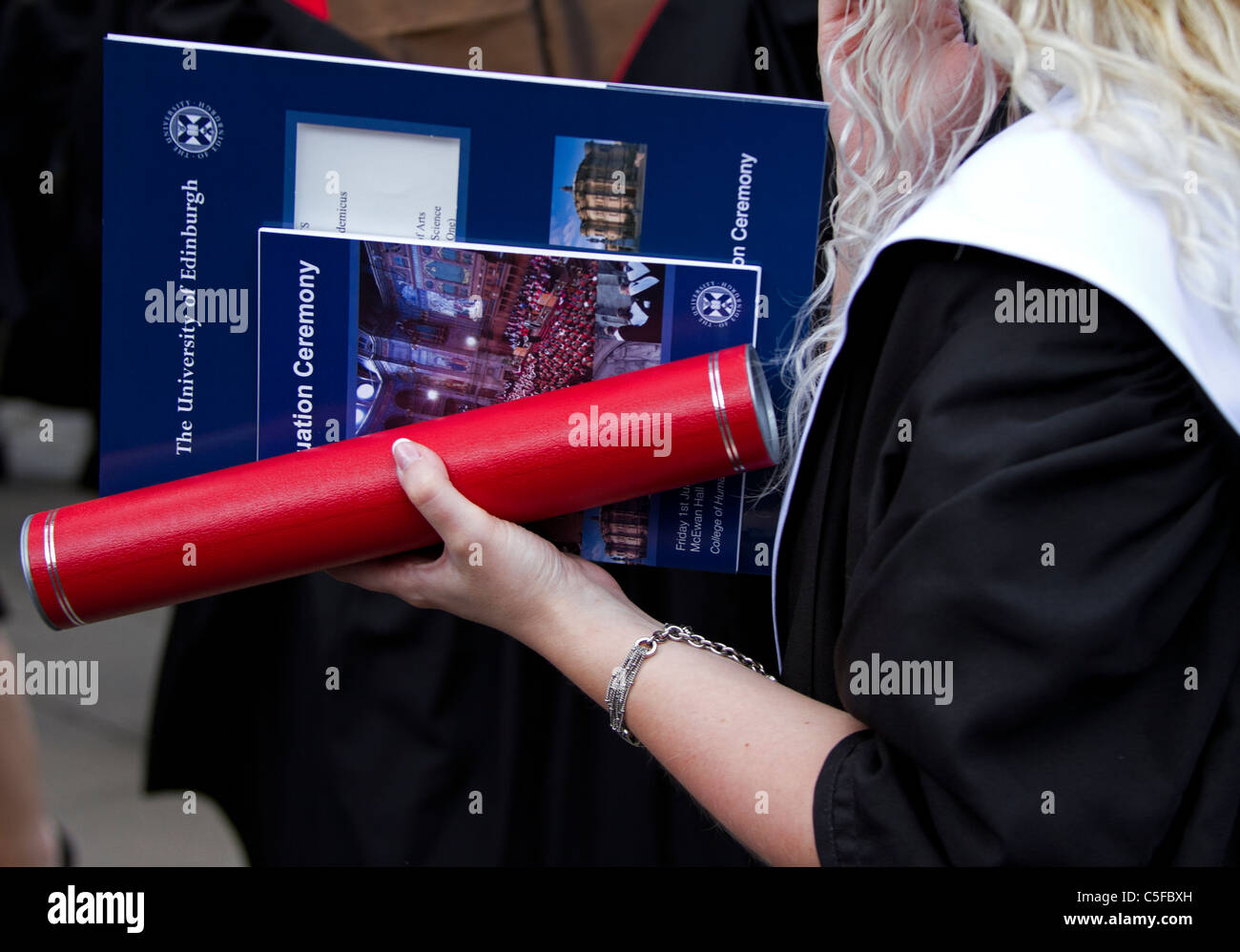 Graduate female student with university diploma scroll, Edinburgh UK Europe - Stock Image