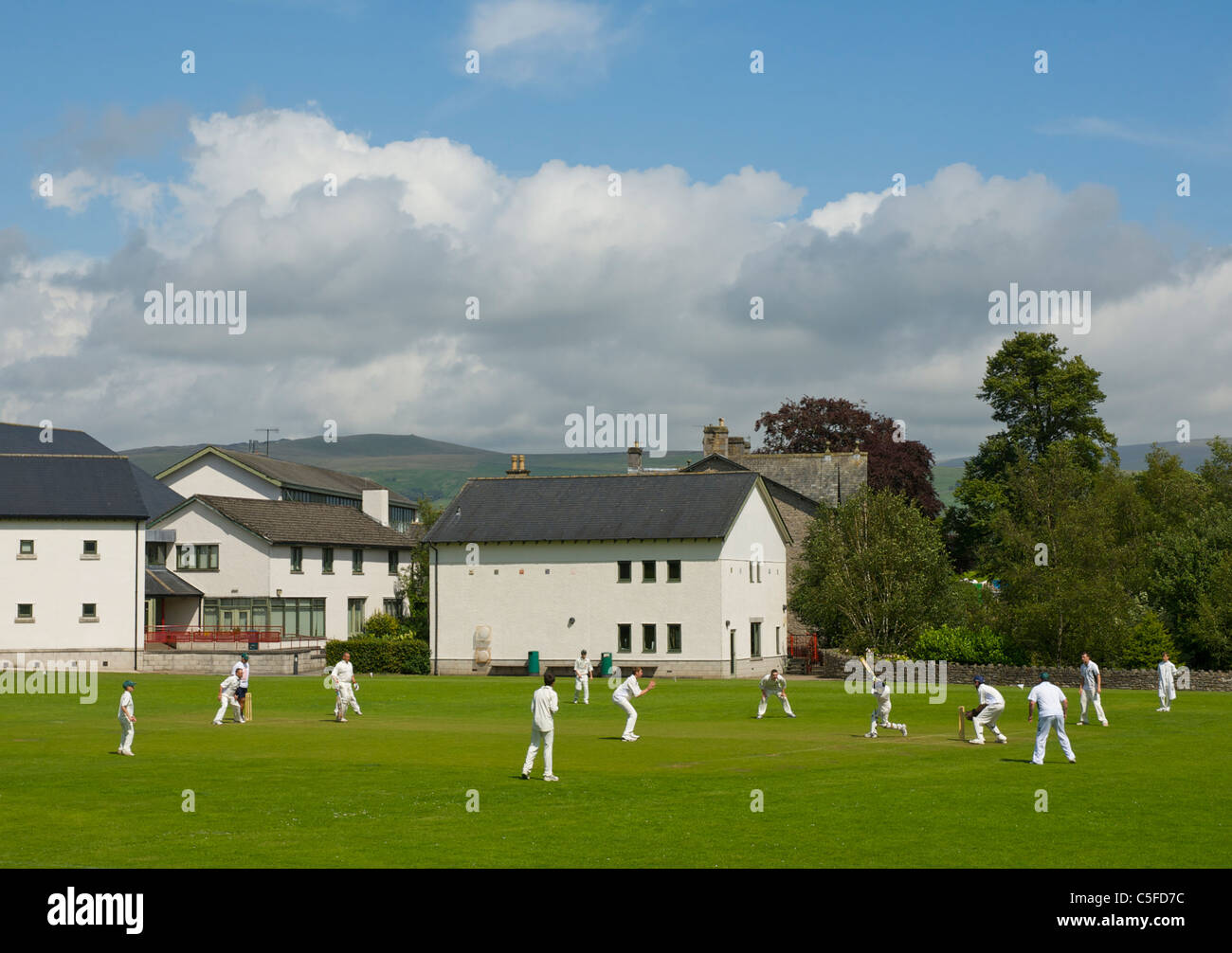Cricket match at Queen Elizabeth School, Kirkby Lonsdale, Cumbria England UK - Stock Image