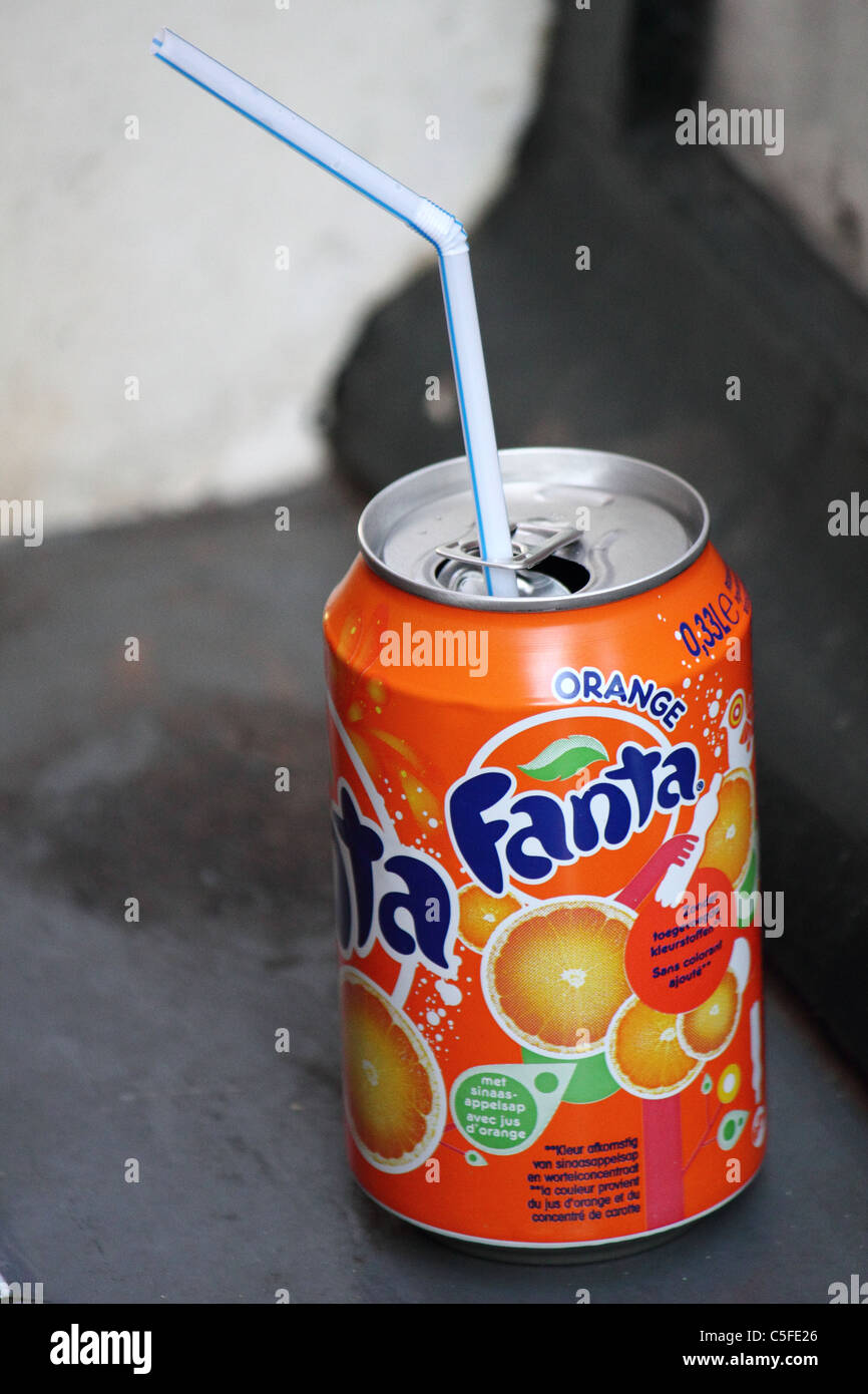 a soda can with reed standing on a windowsill Stock Photo