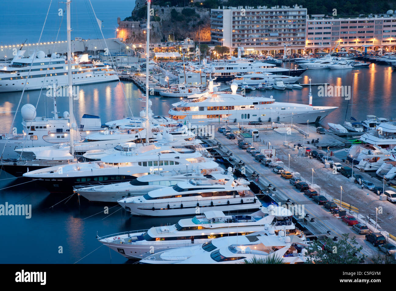 Luxury yachts in the main harbour at dusk, Monte Carlo, Monaco Stock Photo